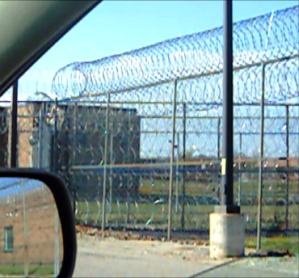 Barbed wire sourrounds the prison where Moore taught meditation and Buddhist religious services. Story by Lindsay H. Passmore